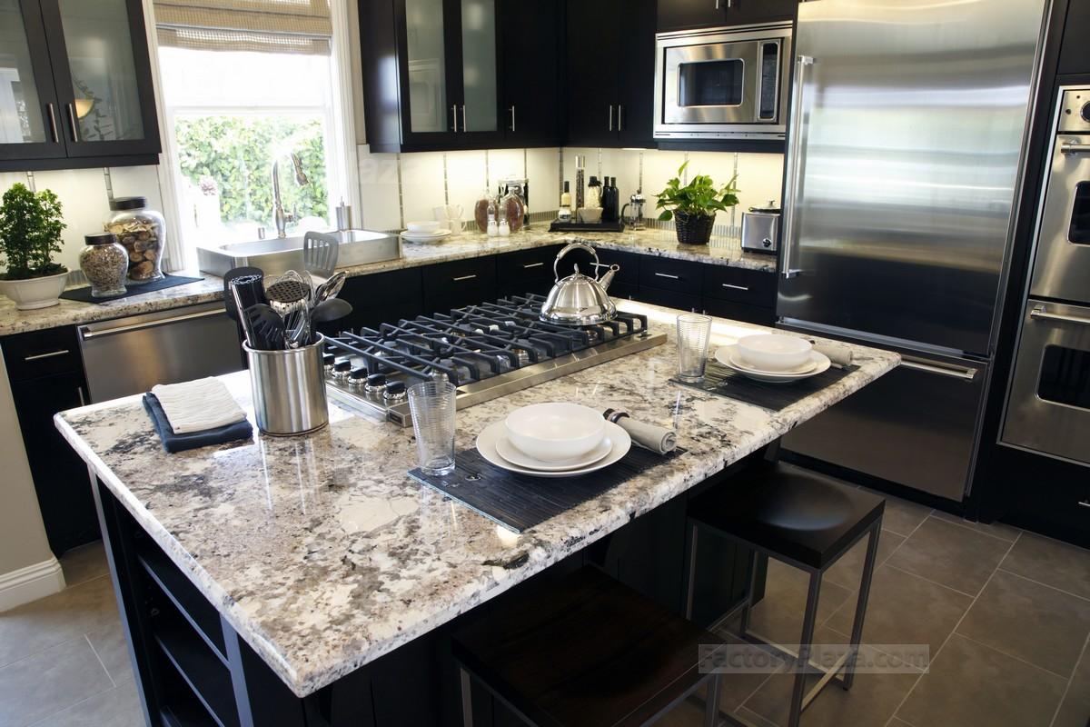 Black kitchen cabinets with Delicatus granite